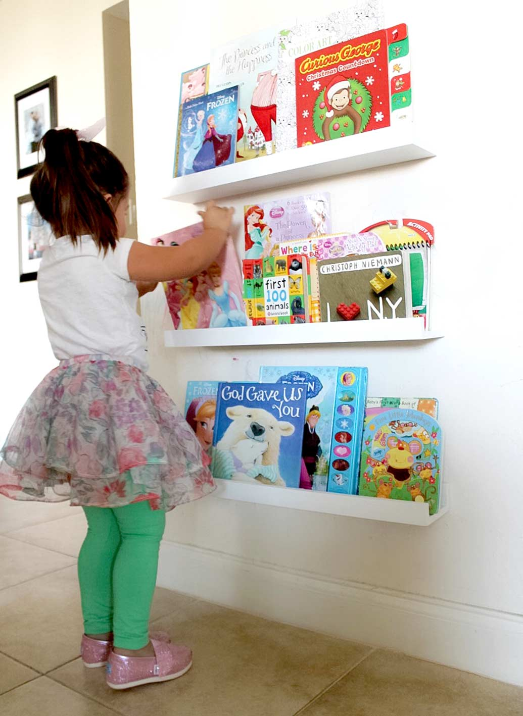 Wall shelves solution for toddler by South Florida Interior Designer