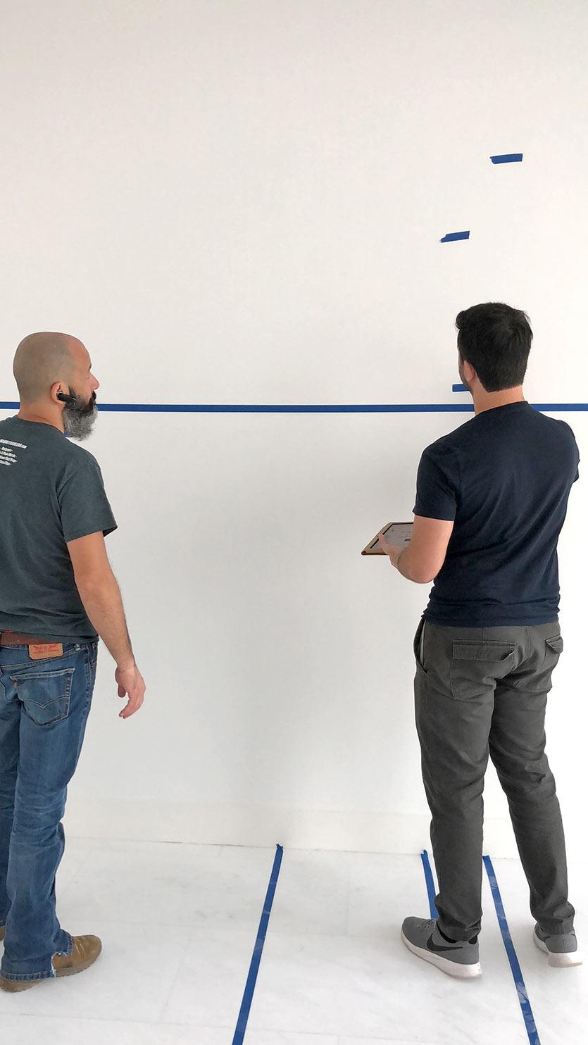 Interior team supervising installations